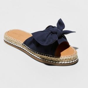 New in box Sigma navy blue bow flat slide sandal